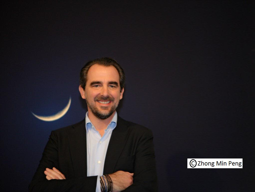 Prince Nikolaos next to the moon in his painting