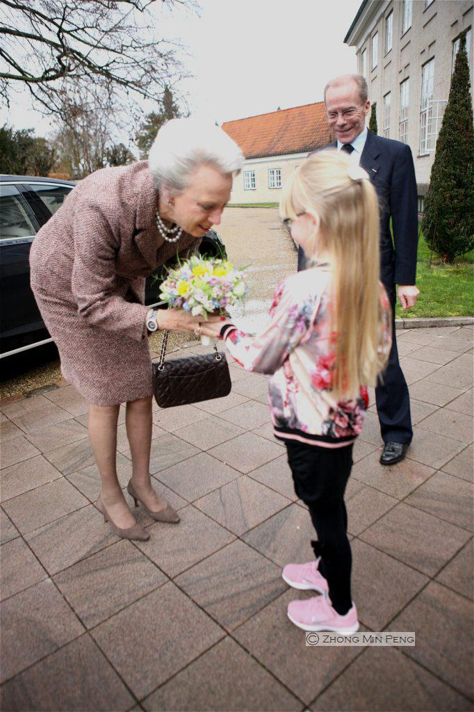 Princess Bendikte receives flowers from a girl at arrival