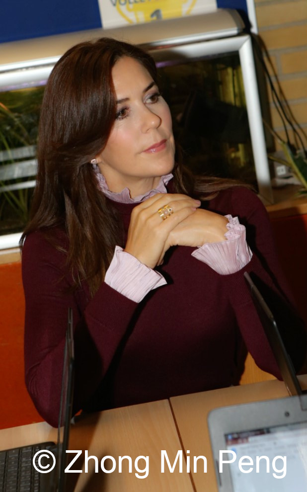 Crownprincess Mary of Denmark concentrates on listening