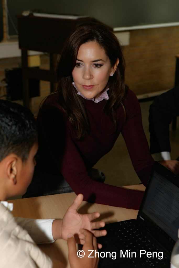 Crownprincess Mary of Denmark listens to a student