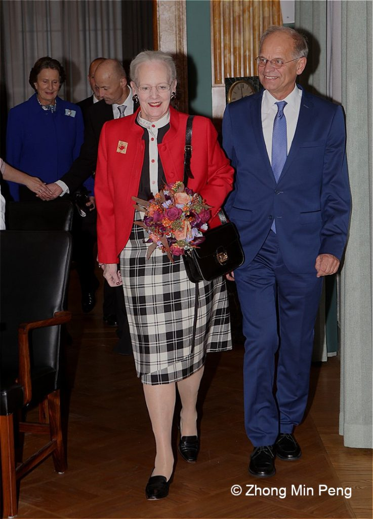 The Queen is accompanied by President Mogens Hoegh Jensen